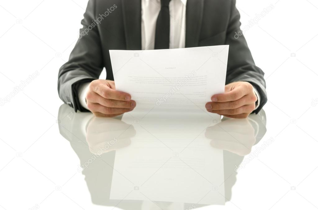 Businessman reading important document