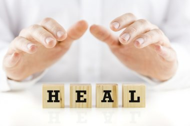 Conceptual image with the word Heal