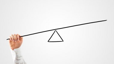 Man constructing a seesaw with a rod and triangle
