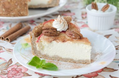 Slice of cheesecake with apples and caramelized pecans