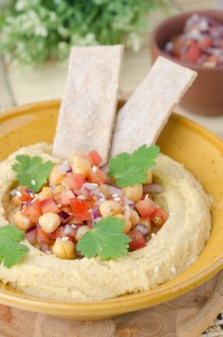 Hummus with a salad of chickpeas and tomatoes