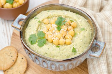 Hummus with cilantro and crackers, top view