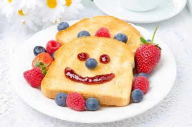 Breakfast with a smiling toast and fresh berries