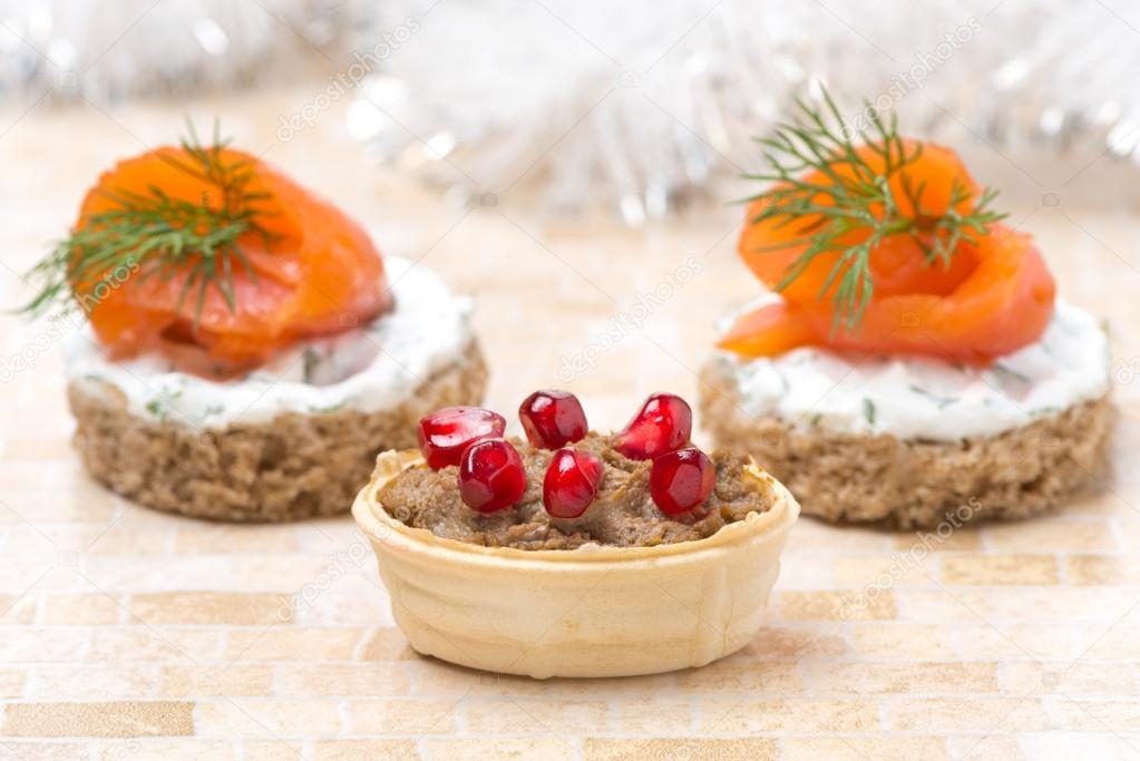 Tartlet with liver pate and pomegranate, canape with salmon