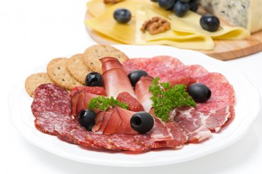 assorted deli meats and a plate of cheese, close-up