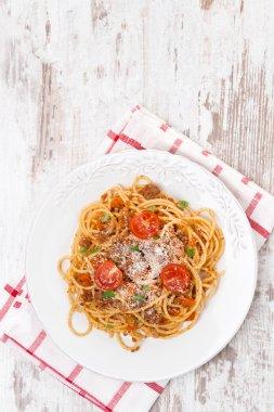 Italian food - spaghetti bolognese, top view, vertical