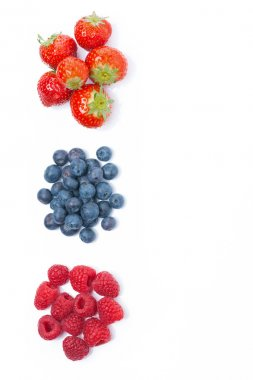 raspberries, blueberries and strawberries, top view, isolated