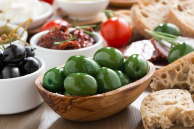 assorted Italian antipasti - olives, pickles and bread