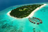 Fotografie Maldivian island with water villas from airplan view