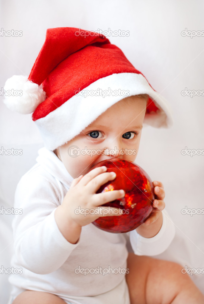 7a2a6b52741 Baby boy with Christmas cap and balls on white background — Photo by  romrodinka