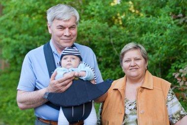 Grandparents with adorable grandchild
