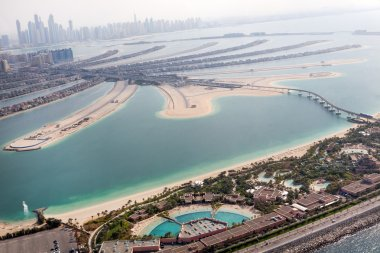 Jumeirah Palm island in Dubai with skyscrappers