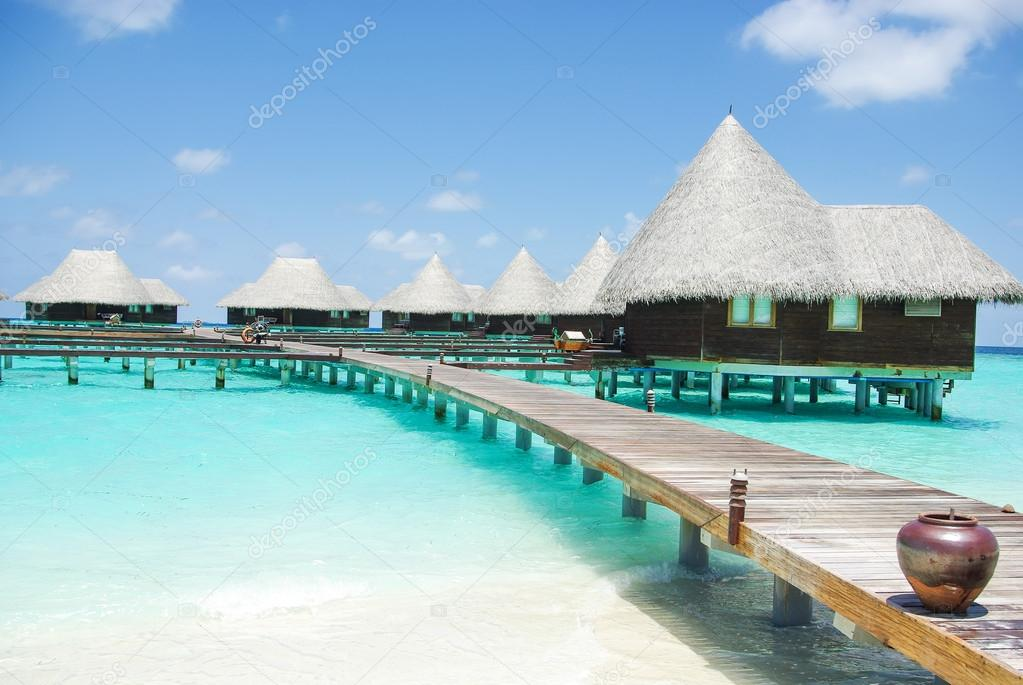 Water villas on tropical island on Maldives