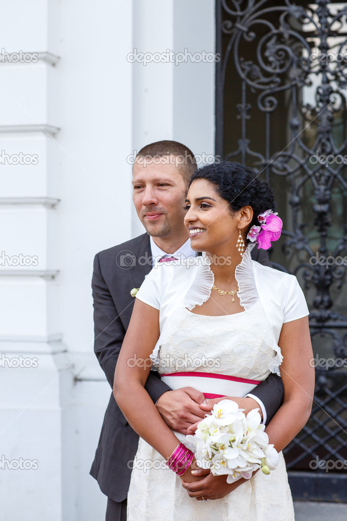 Beautiful Indian Bride And Caucasian Groom After Wedding Ceremo