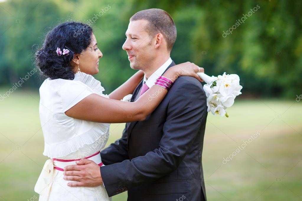 Beautiful Indian Bride And Caucasian Groom In Summer Park Stock