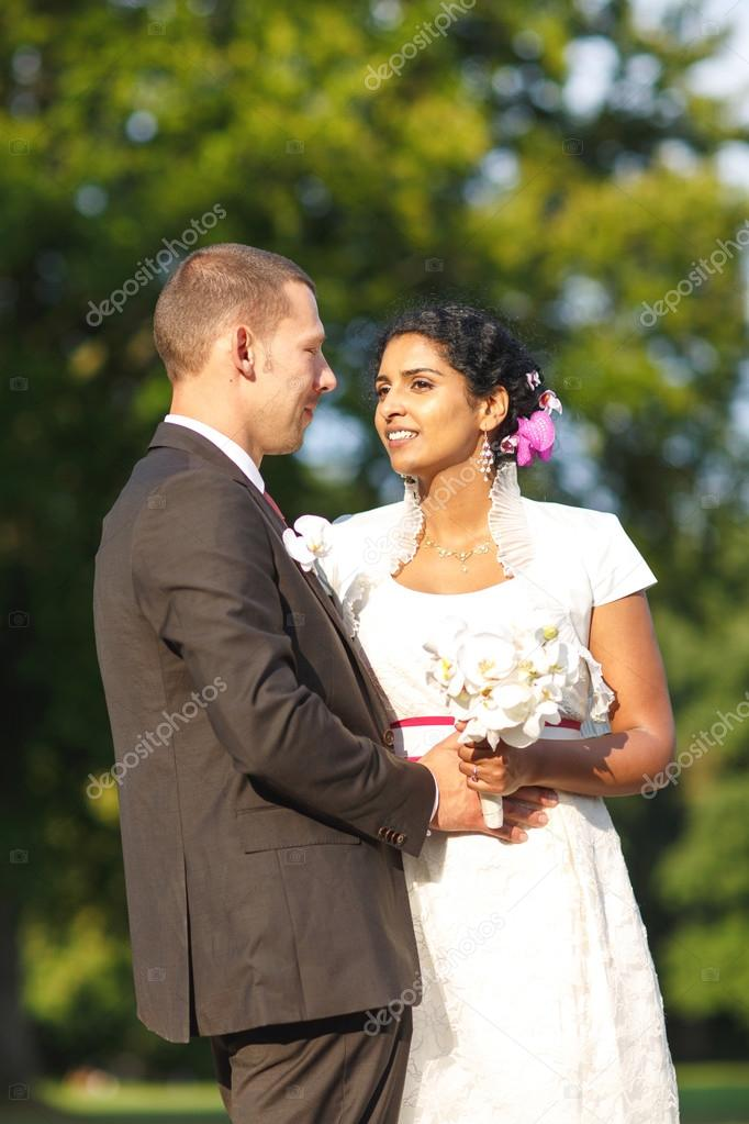 Beautiful Indian Bride And Caucasian Groom In Park Stock Photo