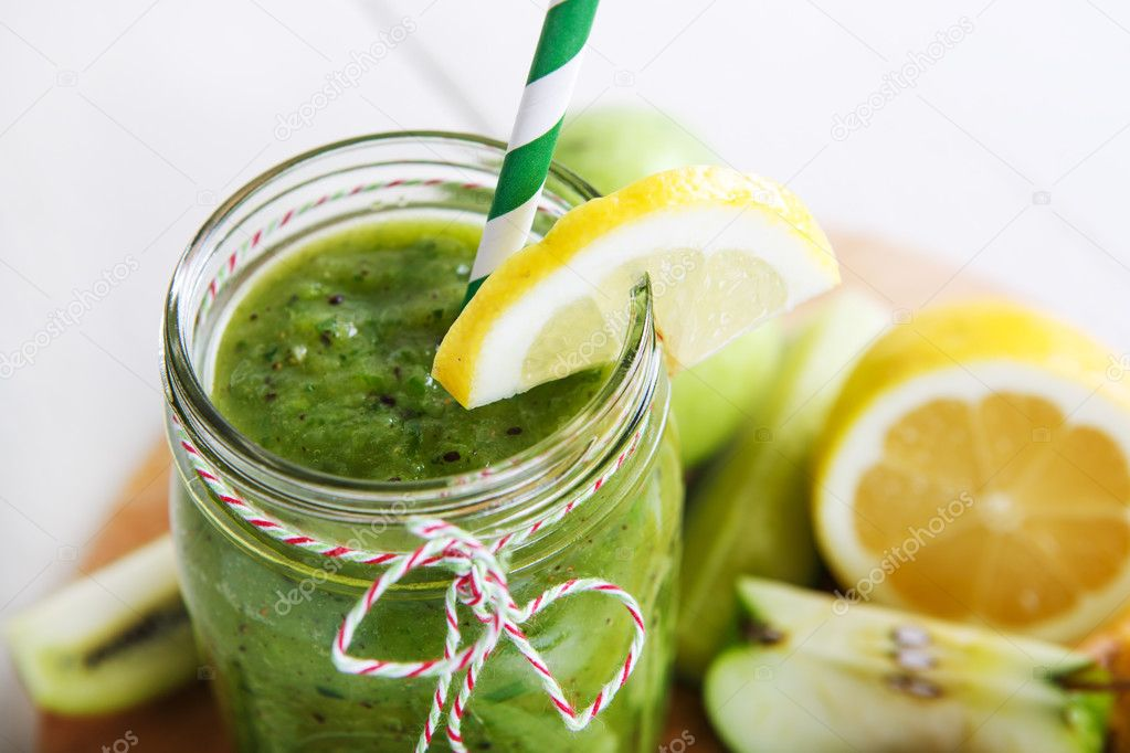 Fresh organic green smoothie with salad, apple, cucumber, pineap