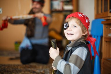 Little preschool boy of 4 years in pirate costume, indoors.