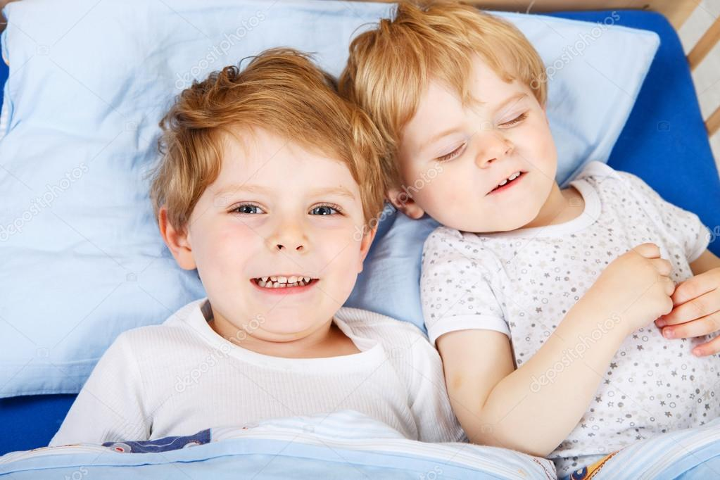 Family Of Two Little Brothers Boys Having Fun In Bed At Home Indoors Photo By Romrodinka