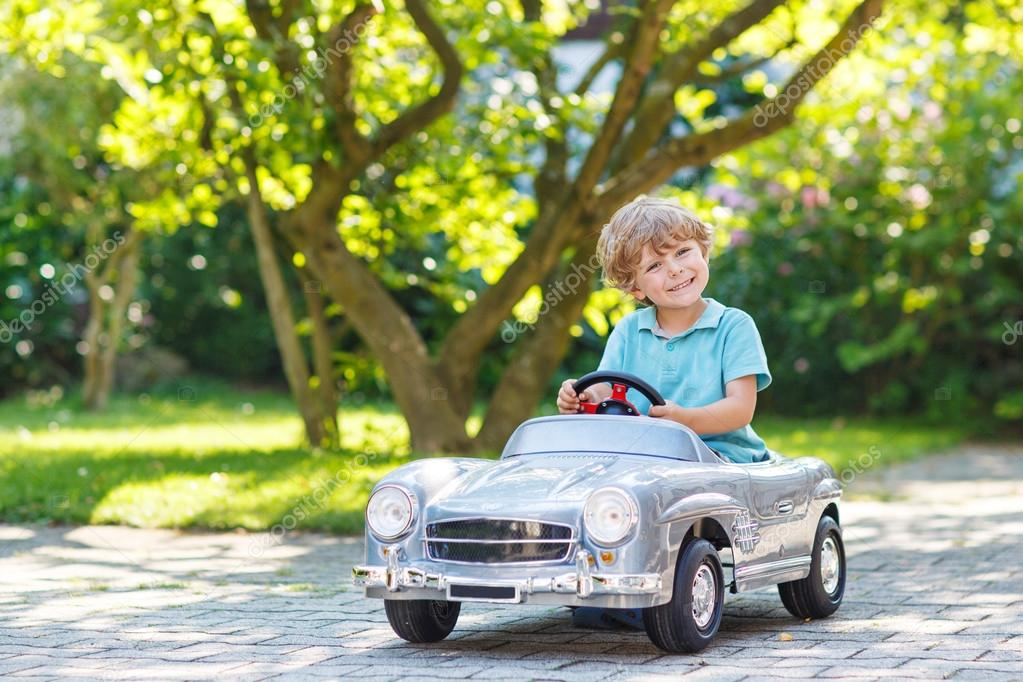 Child Driving Toy Car