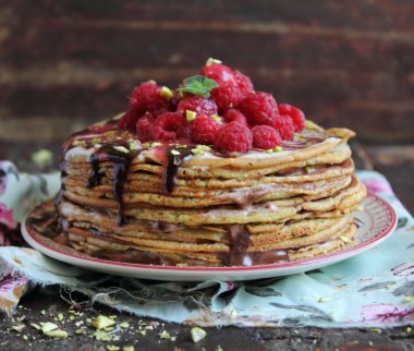 Stack of freshly baked pancakes with chocolate sauce