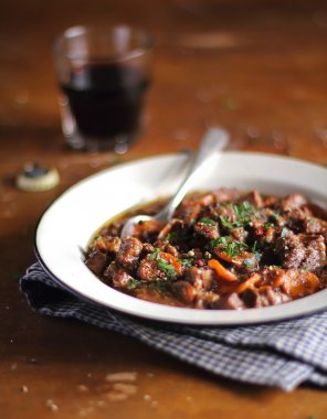 Traditional irish beef stew with carrot, onion and guinness beer in a plate ready for family lunch or dinner