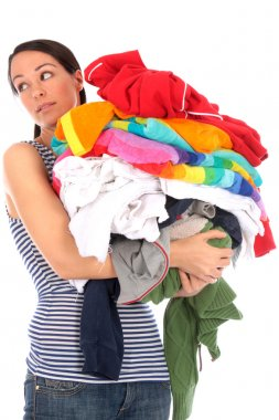 Young Woman Carrying a Pile of Washing