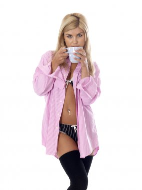 Sexy Young Woman Wearing Pink Shirt Drinking Tea