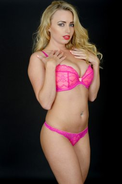 Attractive Young Woman Posing in Pink Sexy Lingeire