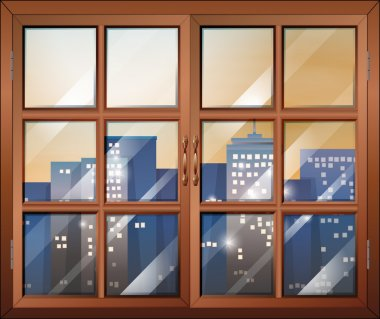 A closed window overlooking the city buildings