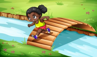 A black girl crossing the wooden bridge