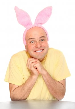 Funny picture of an happy man with pink rabbit ears