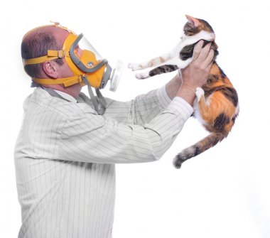 Man in respirator holding his cat.