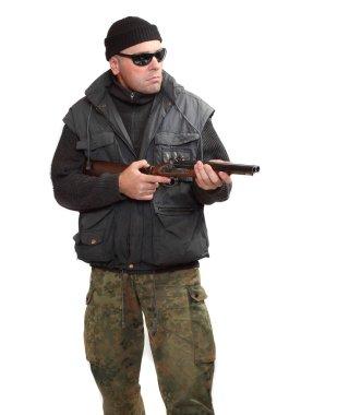 Dangerous gangster or terrorist with shotgun.