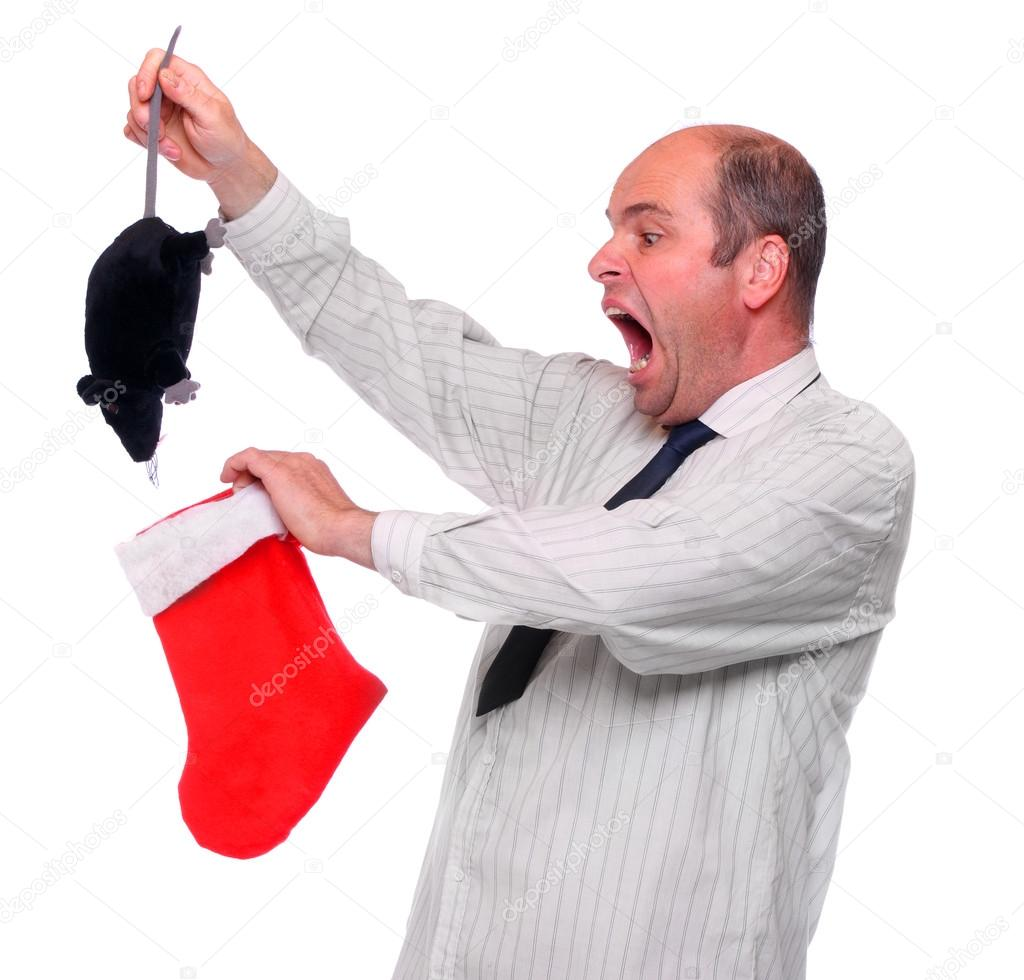 Amazed businessman with unusual christmas bonus. Funny image - crisis metaphor. ( the rat is unauthorized homemade product )