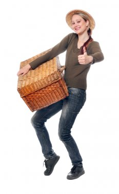 Woman going on vacation with her heavy suitcase.