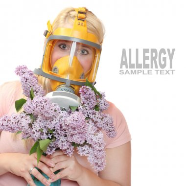 Woman with flowers in protection mask