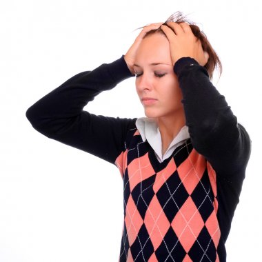 Frustrated student girl with headache on white background.