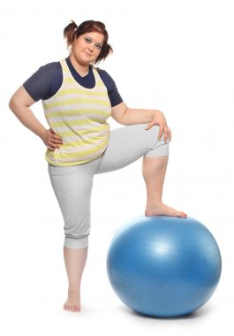 Overweight woman with blue ball