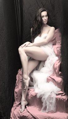 Beautiful woman posing on black background. Fine Art style.
