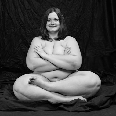 Happy overweight woman in yoga position