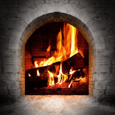 Vintage fireplace with burning logs.