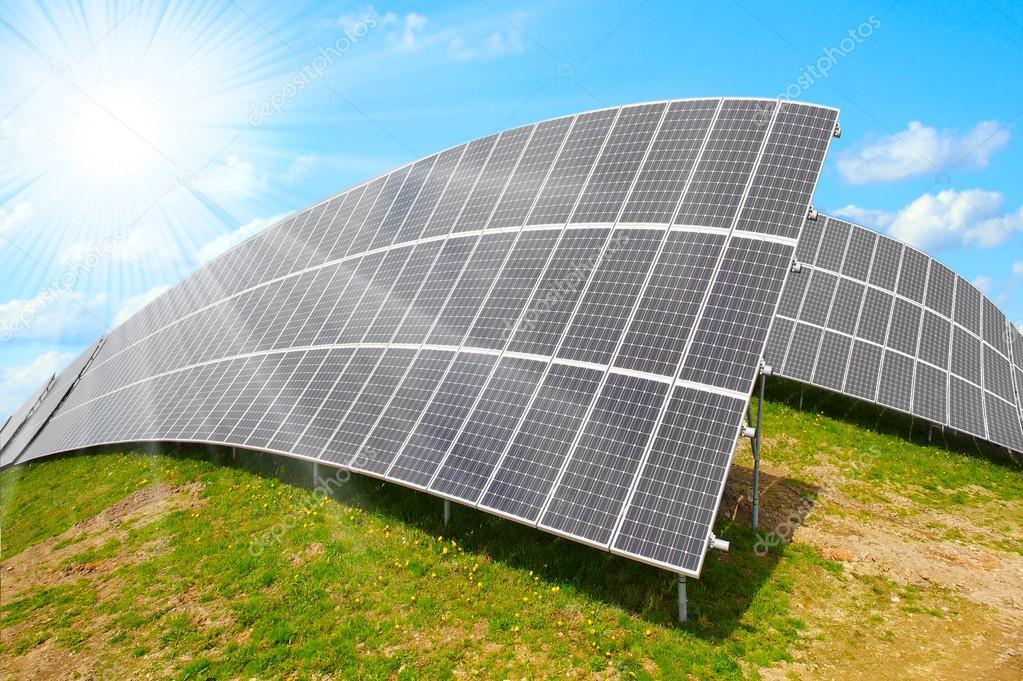 Solar energy panels against sunny sky.