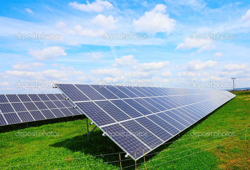 Solar Energy Panels On A Green Wheat Field Stock Photo