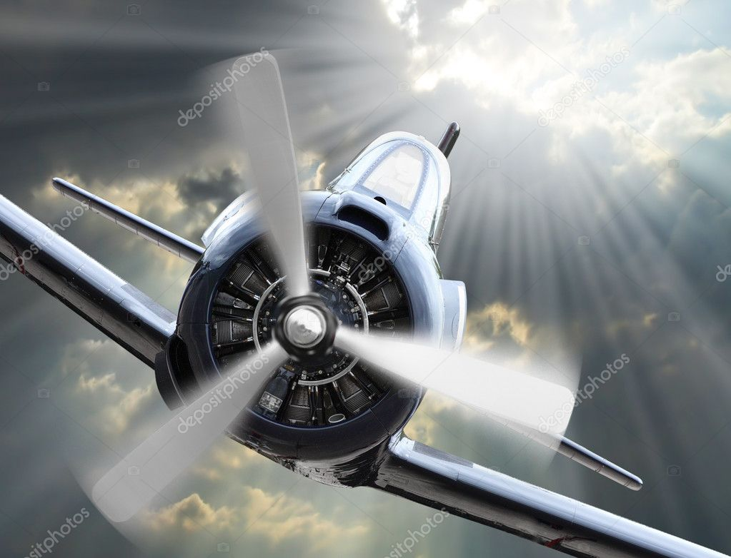 Dramatic scene on the sky. Vintage fighter plane inbound from sun.