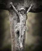Photo Crucifixion of Jesus. Close up of ancient cross at the abandoned grave.