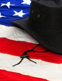 Black leather hat on american flag