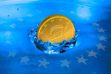 Euro coin falling to the water