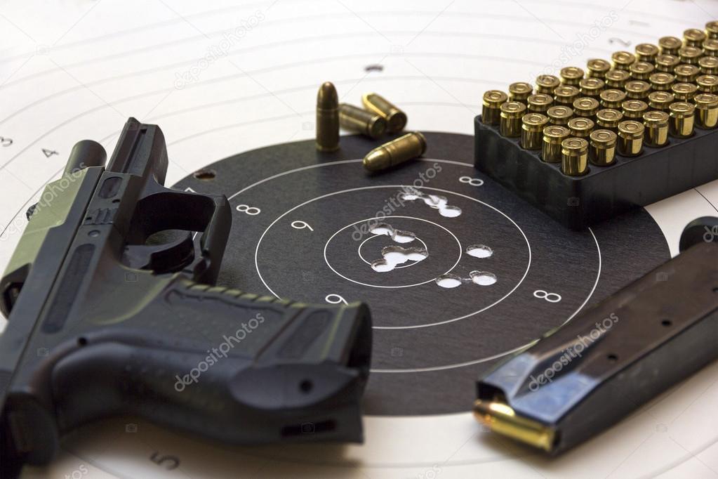Gun and ammunition over bullseye score stock vector