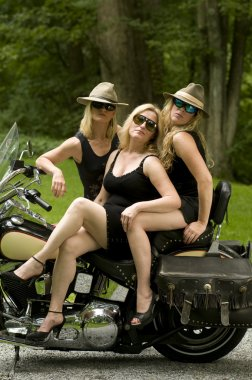 Three sexy middle age women on motorcycle